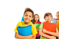 Funny African American school boy with friends Stock Image