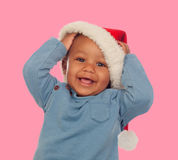 Funny african baby with Christmas cap Royalty Free Stock Photography