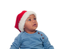 Funny african baby with Christmas hat Stock Photos