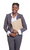 Funny african businesswoman with file Stock Images