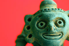 Funny African Pottery. Macro image of a Funny African Pottery over red background Royalty Free Stock Photos