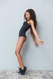 Funny afro american woman posing on tiptoe Royalty Free Stock Photo