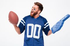 Funny agitated man with toys while posing. Funny agitated male fan with toys while posing Stock Photography
