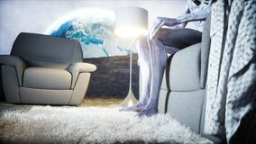 Funny alien watching TV on the sofa on the moon. Living on the moon concept. Earth background. 3d rendering. Funny alien watching TV on the sofa on the moon Royalty Free Stock Image