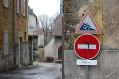 Funny altered no entry sign. Sign seen in Nozeroy, France, altered to look like man carrying a plank Stock Image