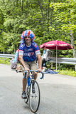 Funny Amateur Cyclist During Le Tour de France. Le Markstein, France- July 13, 2014: Funny amateur cyclists with a French flag colured wig climbing the road to stock photography