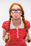 Funny amusing girl in round glasses showing tongue Stock Photos