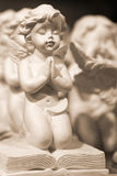 Funny angel boys souvenirs. Funny little angel boys with wings, souvenirs on the desk at a souvenir shop for sale Stock Images