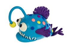 Funny plasticine Anglerfish. Funny Anglerfish made of plasticine royalty free stock photos