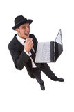 Funny and angry businessman. Angry businessman ready to break his laptop on white from top Stock Images