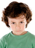 Funny angry child in green Royalty Free Stock Photos