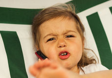 funny angry cute Little kid speak on the phone stock photography