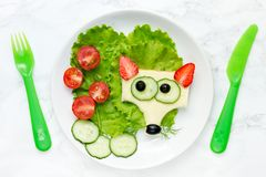 Funny animal face sandwich for children, fox sandwich. With cheese and strawberry stock images