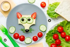 Funny animal face sandwich for children, fox sandwich. With cheese and strawberry royalty free stock photo