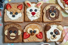 Animal faces toasts with spreads, banana, strawberry and blueberry. Funny animal faces toasts with spreads, banana, strawberry and blueberry stock images