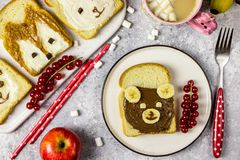 Funny animal sandwich for kids shaped cute bear, panda, fox, rabbit. With peanut butter, honey, chocolate paste and banana. Top vew stock images