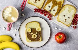 Funny animal sandwich for kids shaped cute bear, panda, fox, rabbit. With peanut butter, honey, chocolate paste and banana. Top vew royalty free stock photos