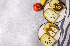 Funny animal sandwich for kids shaped cute bear, panda, fox, rabbit. With peanut butter, honey, chocolate paste and banana. Top vew royalty free stock photography