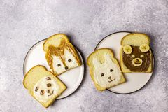 Funny animal sandwich for kids shaped cute bear, panda, fox, rabbit. With peanut butter, honey, chocolate paste and banana. Top vew royalty free stock images