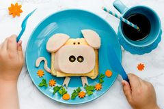 Funny animal sandwich for kids shaped cute pig. With cheese and ham, food art idea stock photography