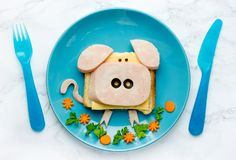 Funny animal sandwich for kids shaped cute pig. With cheese and ham, food art idea royalty free stock image