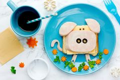 Funny animal sandwich for kids shaped cute pig. With cheese and ham, food art idea royalty free stock photo
