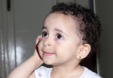 Funny arab baby girl with mobile phone royalty free stock image