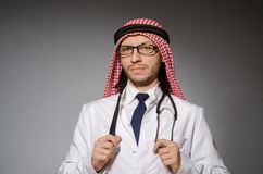 Funny arab doctor. With stethoscope Stock Photos