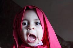 Funny arab egyptian muslim baby girl Royalty Free Stock Photography