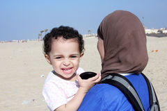 Funny arab muslim egyptian baby girl with her mother Royalty Free Stock Photos