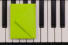 Funny arrangement envelope on the piano keybords Stock Images