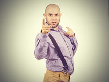 Funny arrogant bald man with a beard. Happy funny arrogant bald man with a beard Stock Images