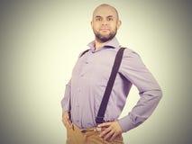 Funny arrogant bald man with a beard. Happy funny arrogant bald man with a beard Royalty Free Stock Image