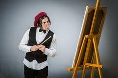 Funny artist in dark studio Stock Photos