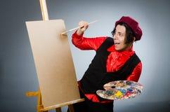 Funny artist in dark studio Stock Photo