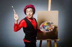 Funny artist in dark studio Stock Photography