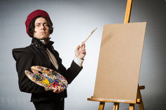Funny artist in dark studio Royalty Free Stock Photo