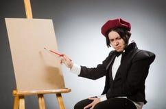 Funny artist in dark studio Royalty Free Stock Image