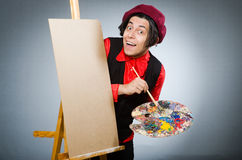 Funny artist in dark studio Royalty Free Stock Photo