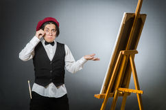 Funny artist in dark studio Royalty Free Stock Photos