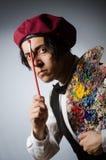 Funny artist in dark studio Royalty Free Stock Images