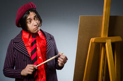 The funny artist with his artwork Royalty Free Stock Photo