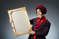 Funny artist with his artwork Stock Images
