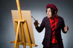 Funny artist with his artwork Stock Image