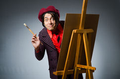 Funny artist with his artwork Stock Photo