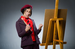 Funny artist with his artwork Royalty Free Stock Image