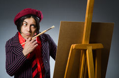 The funny artist with his artwork Stock Photography