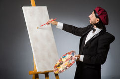 The funny artist working in the studio Royalty Free Stock Photography