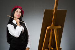 Funny artist working in the studio Stock Images