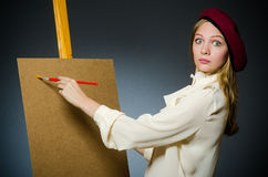 The funny artist working in the studio Stock Photo